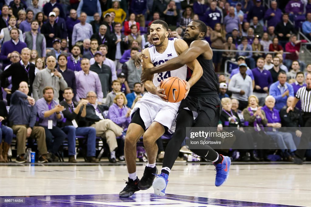 Southern Methodist Mustangs guard Ben Emelogu II (21) is called for a flagrant 1 foul on TCU Horned Frogs guard Kenrich Williams (34) during the game between the SMU Mustangs and TCU Horned Frogs on December 5, 2017 at Ed & Rae Schollmaier Arena in Fort Worth, TX.