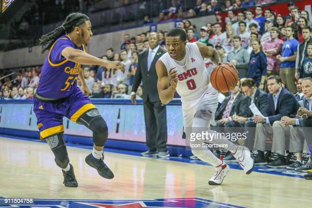 Southern Methodist Mustangs guard Jahmal McMurray drives to the basket against East Carolina Pirates guard Shawn Williams during the game between SMU...