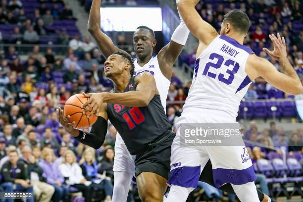 Southern Methodist Mustangs guard Jarrey Foster splits the TCU Horned Frogs defense during the game between the SMU Mustangs and TCU Horned Frogs on...