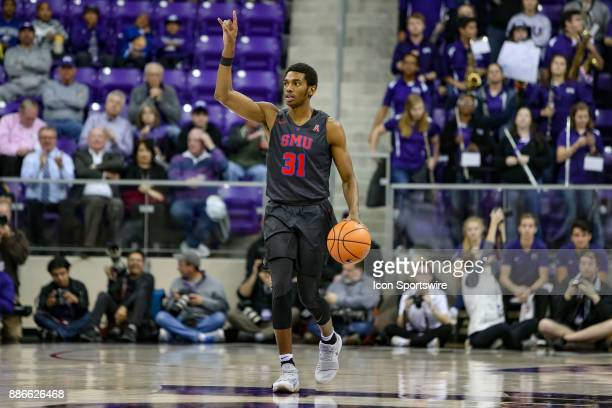 Southern Methodist Mustangs guard Jimmy Whitt brings the ball up the court during the first half between the SMU Mustangs and TCU Horned Frogs on...