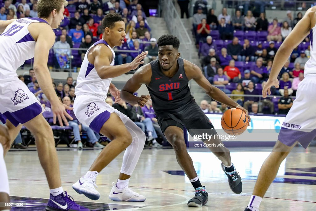 Southern Methodist Mustangs guard Shake Milton (1) drives the lane around TCU Horned Frogs guard Desmond Bane (1) during the game between the SMU Mustangs and TCU Horned Frogs on December 5, 2017 at Ed & Rae Schollmaier Arena in Fort Worth, TX.