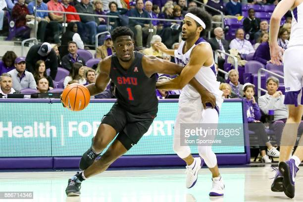 Southern Methodist Mustangs guard Shake Milton drives the lane around TCU Horned Frogs guard Shawn Olden during the game between the SMU Mustangs and...