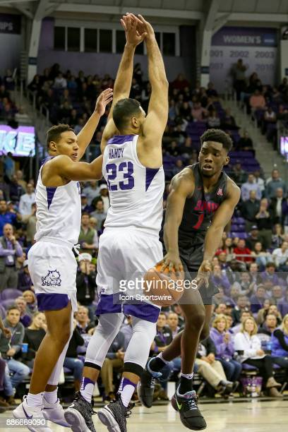 Southern Methodist Mustangs guard Shake Milton passes the ball behind TCU Horned Frogs forward Ahmed HamdyMohamed during the game between the SMU...