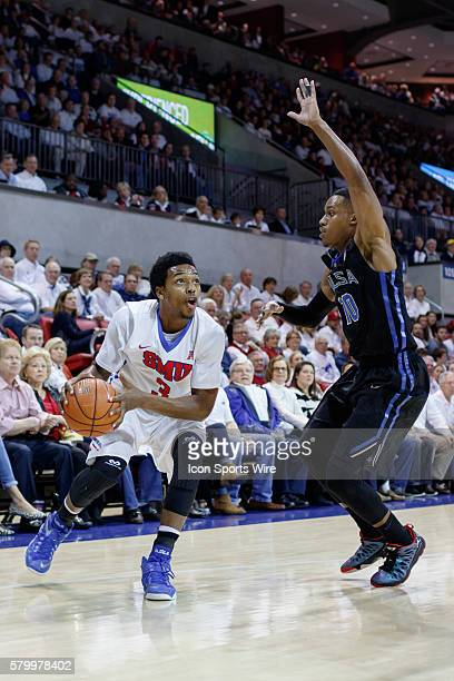 Southern Methodist Mustangs guard Sterling Brown drives around Tulsa Golden Hurricane guard James Woodard during the NCAA Basketball game between the...