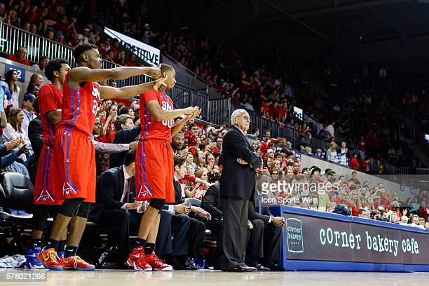 Southern Methodist Mustangs head coach Larry Brown and his players look on during the NCAA men's basketball game between the University of...
