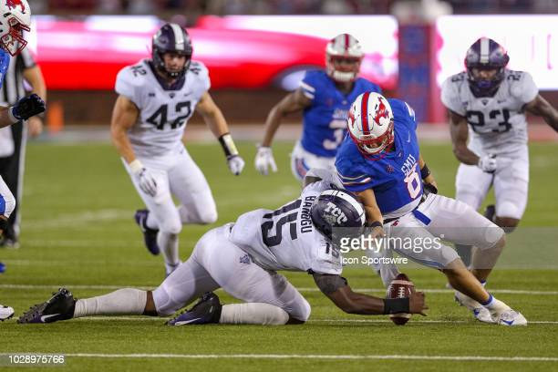 Southern Methodist Mustangs quarterback Ben Hicks is stripped of the ball by TCU Horned Frogs defensive end Ben Banogu during the football game...