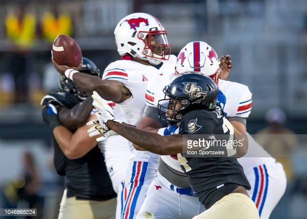 Southern Methodist Mustangs quarterback William Brown gets sacked by UCF Knights linebacker Gabriel Luyanda during the football game between the UCF...