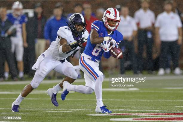Southern Methodist Mustangs running back Braeden West drops a pass with TCU Horned Frogs linebacker Arico Evans defending during the football game...