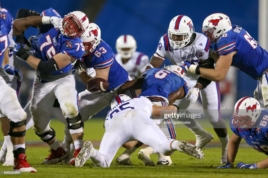 Southern Methodist Mustangs running back Braeden West (6) fumbles the ball during the DXL Frisco Bowl game between the Louisiana Tech Bulldogs and SMU Mustangs on December 20, 2017 at Toyota Stadium in Frisco, TX.