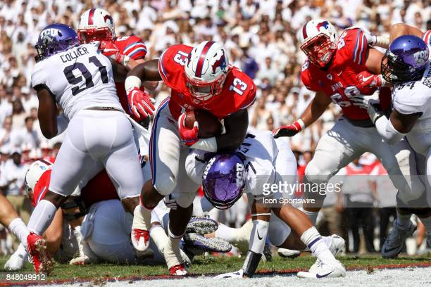 Southern Methodist Mustangs running back Ke'Mon Freeman runs through a tackle attempt by TCU Horned Frogs linebacker Arico Evans for a touchdown...