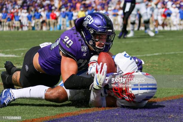 Southern Methodist Mustangs running back Xavier Jones is tackled just short of the goal line by TCU Horned Frogs linebacker Garret Wallow during the...