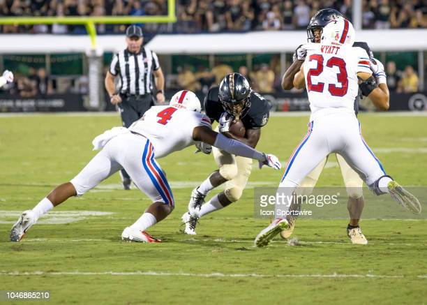 Southern Methodist Mustangs safety Mikial Onu tackles UCF Knights running back Otis Anderson during the football game between the UCF and SMU on...