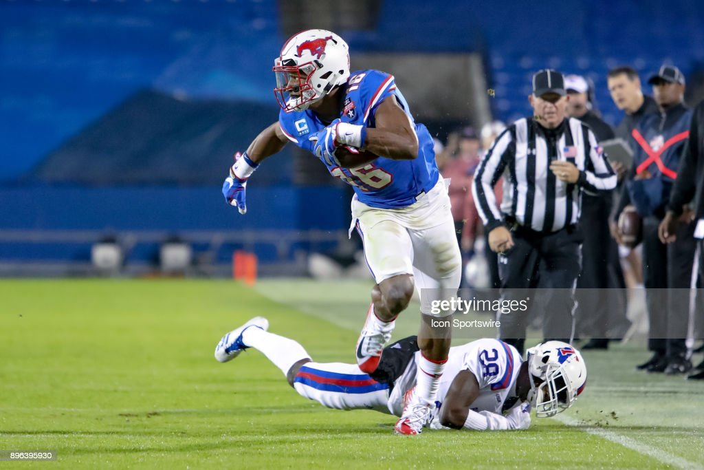 Southern Methodist Mustangs wide receiver Courtland Sutton (16) breaks free from a tackle attempt by Louisiana Tech Bulldogs safety Jordan Baldwin (28) during the DXL Frisco Bowl game between the Louisiana Tech Bulldogs and SMU Mustangs on December 20, 2017 at Toyota Stadium in Frisco, TX.