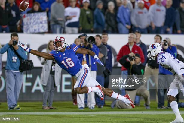 Southern Methodist Mustangs wide receiver Courtland Sutton dives for an overthrown pass during the DXL Frisco Bowl game between the Louisiana Tech...