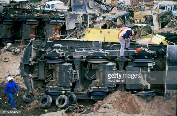 Southern Pacific rail cars are piled onto each other after the run-a-way engine crashed after coming down the Cajon Pass, May 13,1989 in Rialto,...