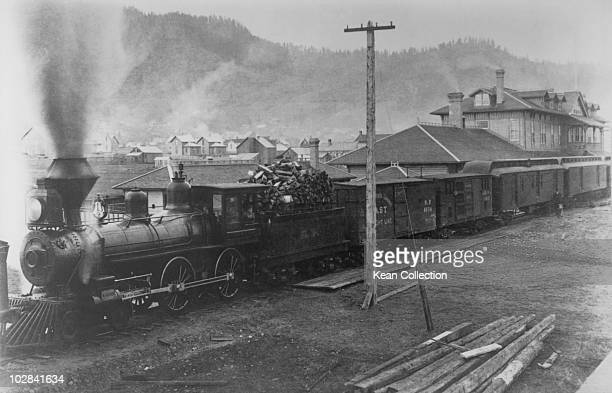 A Southern Pacific RR 440 locomotive at the head of a passenger train Ashland Oregon circa 1887