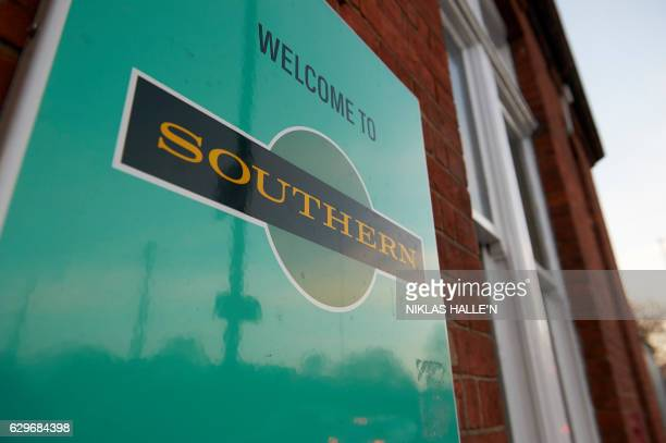 A Southern Rail logo is displayed on a sign outside Selhurst train station which is closed as train drivers stage a second day of industrial action...