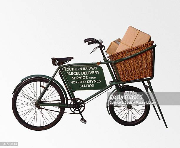Southern Railway parcel delivery service bicycle from Horsted Keynes station West Sussex with parcels piled in the front basket Bicycles were used by...