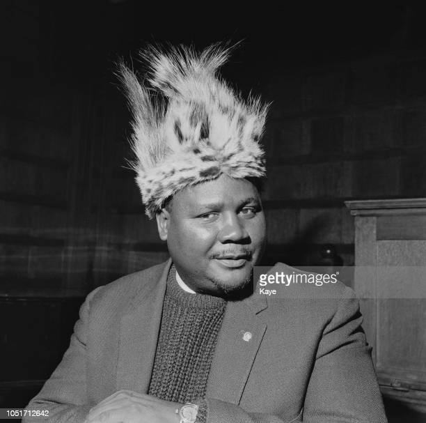 Southern Rhodesian politician trade unionist and president of the National Democratic Party Joshua Nkomo pictured wearing a ceremonial fur hat for a...