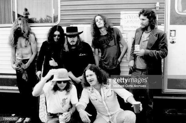 Southern Rock band Lynyrd Skynyrd pose by their trailer backstage at an outdoor concert in October 1976 in California