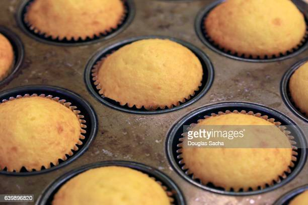 Southern Style Corn bread muffins cooking in a baking pan