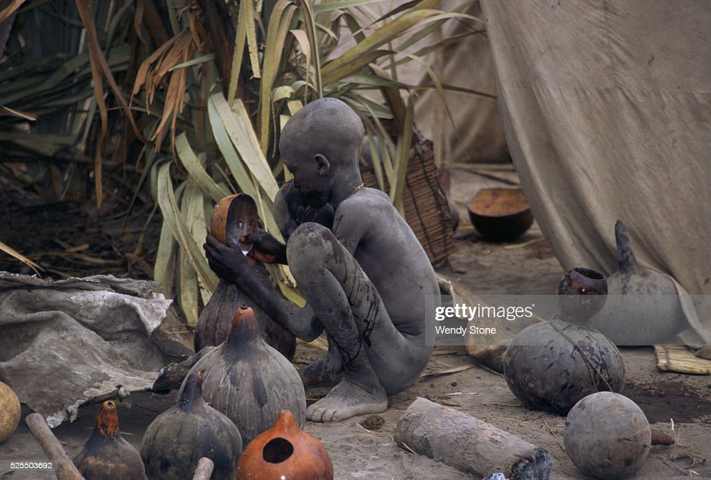 Dinka people in south sudan pictures getty images southern sudan bahr el ghazal province dinka cattle camps a dinka boy covered sciox Images