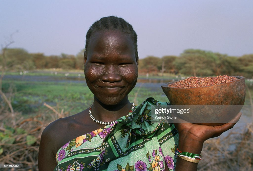 Nuer people in south sudan pictures getty images southern sudan jiech nuer peoples a young nuer woman with a tattooed sciox Images