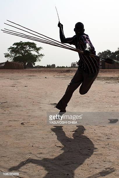 A southern Sudanese boy from the Nuer tribe performs a spear dance in Bentiu on January 10 2011 on the second day of a landmark independence...