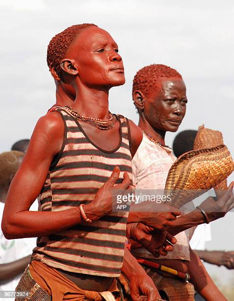 Southern Sudanese dancers from the Mundari ethnic group welcome former US president Jimmy Carter in the Central Equatorian village of Lojura on...