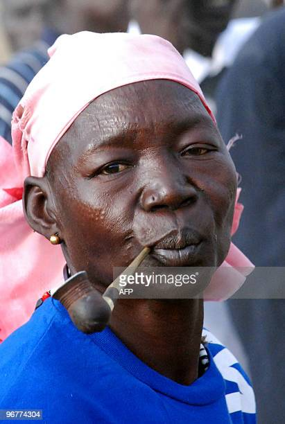 Southern Sudanese woman from the Mundari ethnic group dances during a welcoming ceremony for former US president Jimmy Carter in the Central...