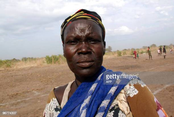 Southern Sudanese woman from the Mundari ethnic group waits for the arrival of former US president Jimmy Carter in the Central Equatorian village of...