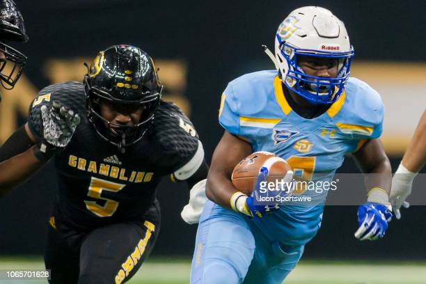 Southern University Jaguars running back Devon Benn attempts to evade the tackle of Grambling State Tigers linebacker De'Arius Christmas during the...