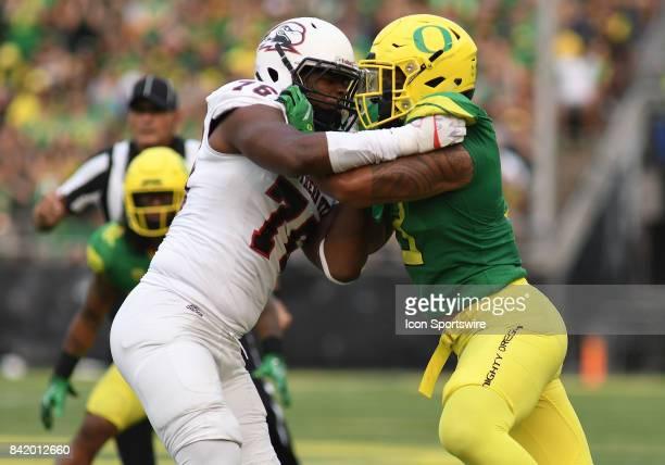 Southern Utah OL Marquez Tucker blocks University of Oregon OLB Jonah Moi during an NCAA football game between the Southern Utah Thunderbirds and...