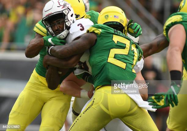 Southern Utah QB Patrick Tyler runs through the tackle attempt by University of Oregon S Mattrell McGraw for a touchdown in the first quarter during...
