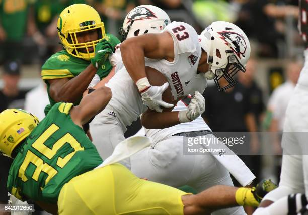 Southern Utah RB James Felila runs for a gain and is tackled by University of Oregon ILB Troy Dye during an NCAA football game between the Southern...