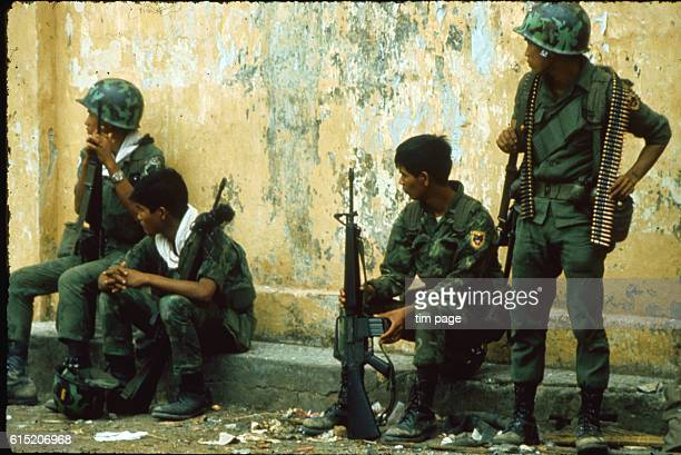 Southern Vietnamese rangers find a moment's rest during the battle for Cholon Post Office in May 1968 Saigon Vietnam