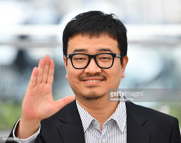 SouthKorean director Yeon SangHo poses during the photocall for the film 'BuSanHaeng ' at the 69th annual Cannes Film Festival in Cannes on May 14...