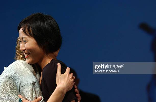 """South-Korean film director Gina Kim is congratulated by US actress Vera Farmiga after their film """"Never Forever"""" won the Jury Prize of the Deauville..."""