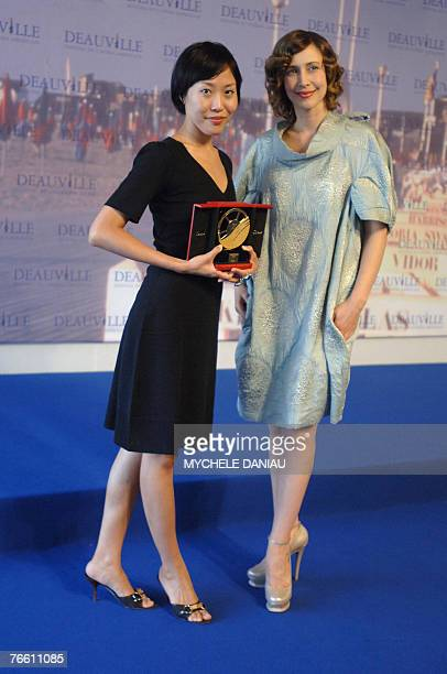 """South-Korean film director Gina Kim poses with US actress Vera Farmiga after their film """"Never Forever"""" won the Jury Prize of the Deauville Film..."""