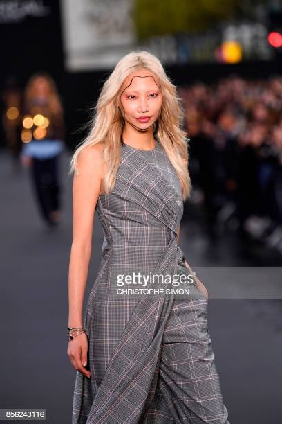 SouthKorean model Soo Joo Park walks during the L'Oreal fashion show which theme is Paris on the sidelines of the Paris Fashion Week on October 1 on...