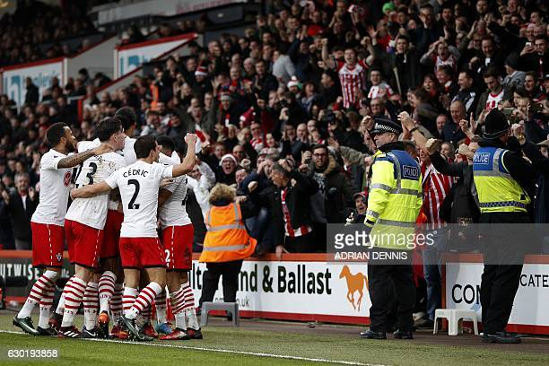 Southmapton players celebrate in front of their fans after Southampton's English striker Jay Rodriguez scored his team's third goal during the...