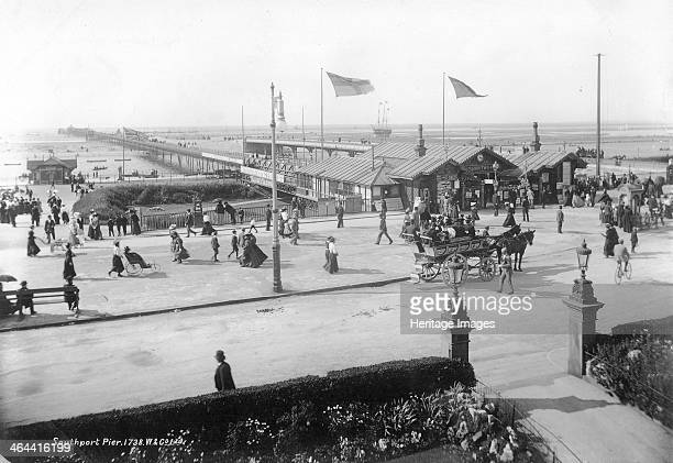 Southport Pier, Southport, Lancashire, 1890-1910. A view of Southport Pier from the seafront with holidaymakers and a horse-drawn vehicle. Southport...