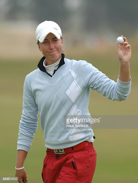 Southport, UNITED KINGDOM: Sweden's Louise Stahle celebrates after a birdie on the 18th hole puts her in the lead on the second day of the Womens...