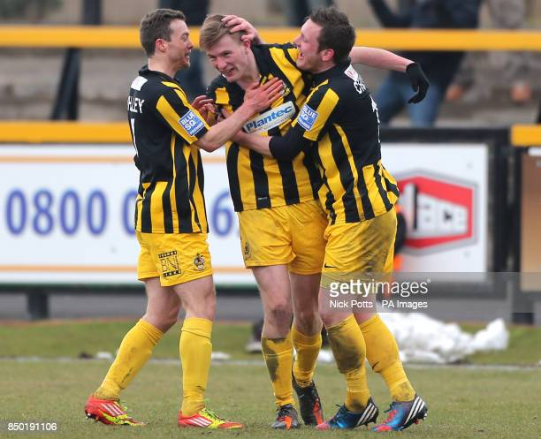 Southport's Danny Hattersley celebrates scoring with Aaron Chalmers and Shaun Whalley