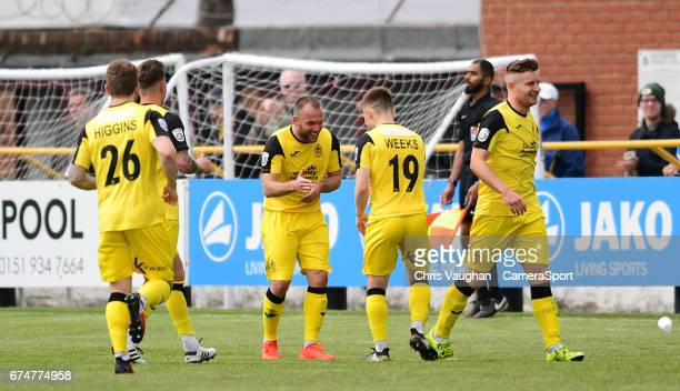 Southport's Neil Ashton centre celebrates scoring his sides equalising goal to make the score 11 during the Vanarama National League match between...