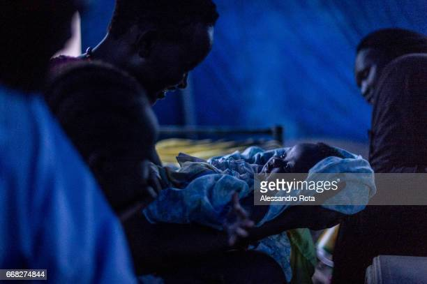 18 OCT 2015 SouthSudan Abuyung village Lake State A mum with her baby in the main market of Abuyung village after a storm has hit The town is...