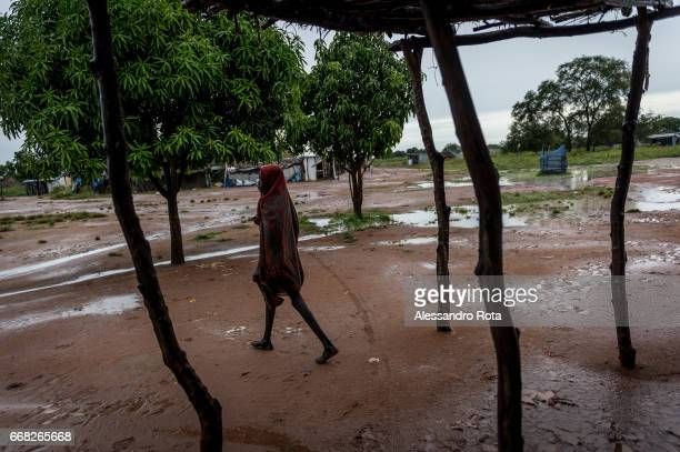 18 OCT 2015 SouthSudan Abuyung village Lake State A young lady cross the main market of Abuyung village after a storm has hit The town is becoming a...