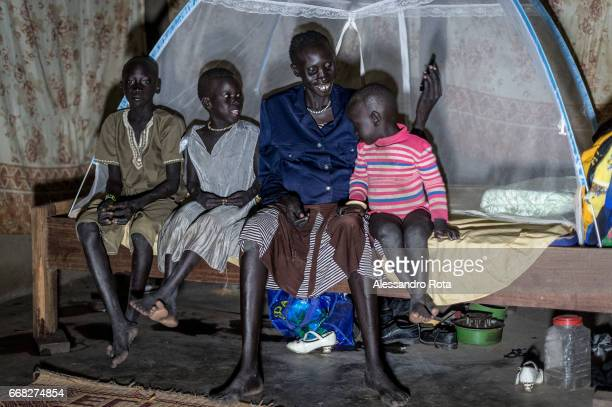 18 OCT 2015 SouthSudan Abuyung village Lake State Adut Lueth unknown age 4 children pregnant of the the 5th She was originially from Bor but was...