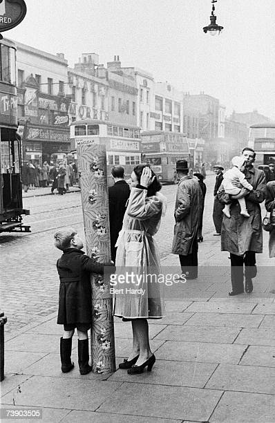 Southwark shoppers bring home their bargains bought in the market at the Elephant and Castle South London 8th January 1949 Original Publication...