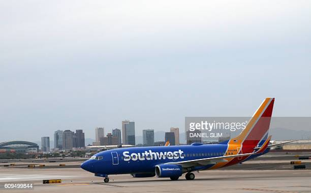 A Southwest airline plane is seen on the tarmac at Phoenix Sky Harbor International Airport on September 19 2016 in Phoenix Arizona / AFP / Daniel...